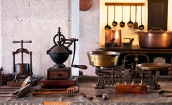 Vintage and antique kitchen utensils arranged on a work top in old palace kitchen in Portugal.