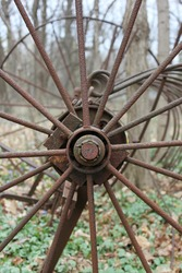 Vintage and rustic covered wagon wheel.