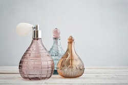 Vintage antique bottles with perfume on blue background