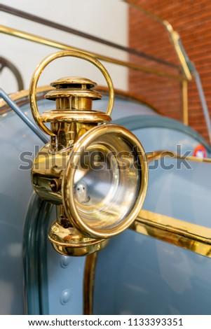 Vintage antique brass auto car headlight. Oldtimer head lamp. #1133393351