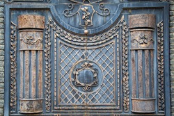 Vintage antique castle gate.  Ancient aged closed, black iron metal door gate