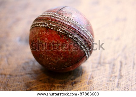 Vintage antique cricket ball on wood