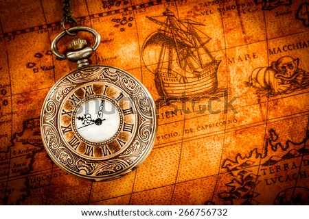 Free photos vintage antique pocket watch on old map background vintage antique pocket watch on an ancient world map in 1565 266756732 gumiabroncs Gallery