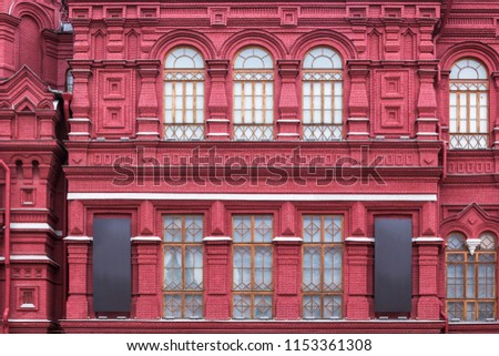 Vintage architecture red brick classical facade in.pseudo-Russian style.  Front view close up #1153361308