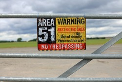 Vintage Area 51 Warning Sign Hanging On A Gate. Extraterrestrial Storage Facility Concept.