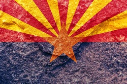 Vintage Arizona state flag icon pattern isolated on weathered solid rock wall background, abstract positive design faithful USA Arizona politics society concept texture wallpaper