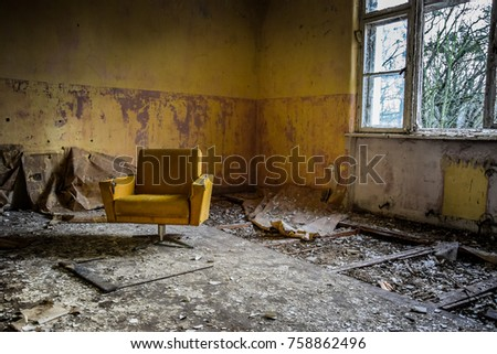 Stock Photo Vintage armchair in an abandoned room