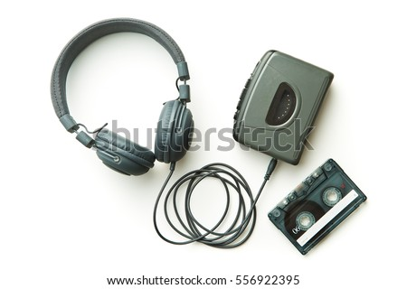 Photo of  Vintage audio player, audio tape and headphones isolated on white background.