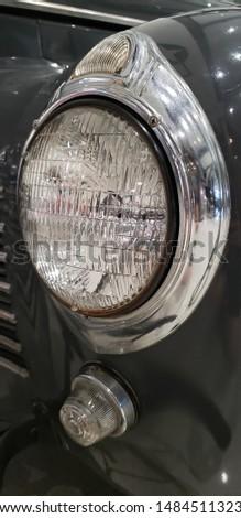 vintage automobile chrome headlight detail #1484511323
