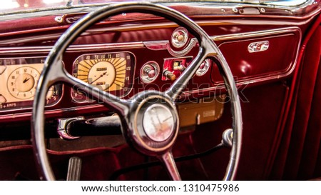 Vintage automobile vehicle car steering wheel and push button dashboard #1310475986