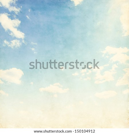 Vintage background of blue cloudy sky.