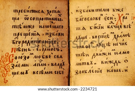 Vintage background-old book open on both  shabby pages with text on slavonic. Paper with stains and scratches.