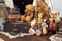 Vintage background with collection of antique childhood treasures - dolls and toys