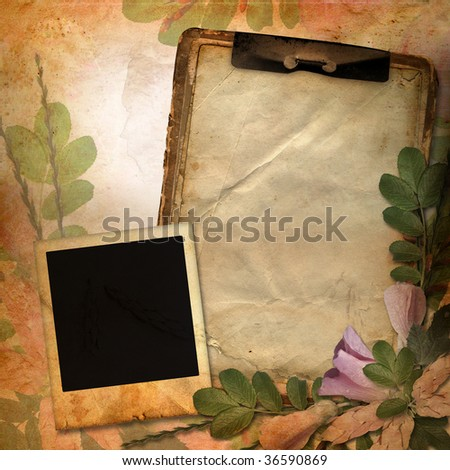 Vintage background with frame for photo, notebook and flower composition.