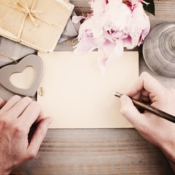 Vintage Background with Male Hands, Pen and Paper. Man Writing Love Letter