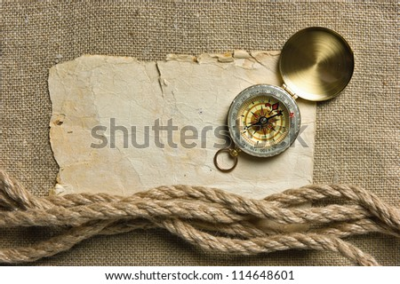 Vintage background with old paper and compass
