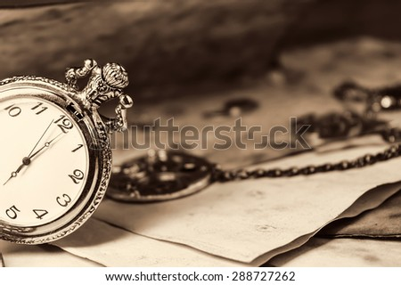 Vintage background with old watch