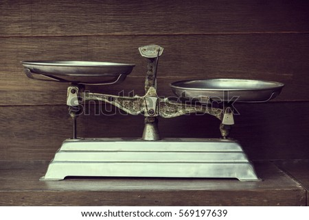 Vintage balance on wood background