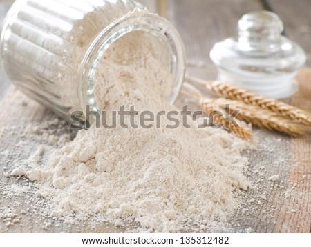 Vintage bank with whole wheat flour, selective focus