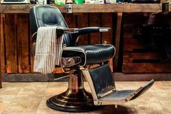 Vintage barber chair. Barbershop business. Barber shop chair. Modern hairdresser and hair salon. Barber shop for men. Barbershop theme. Barbershop interior. Stylish vintage barber chair.