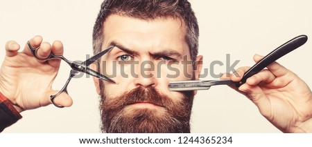 Vintage barbershop, shaving. Bearded man, bearded male. Portrait of stylish man beard. Barber scissors and straight razor, barber shop.
