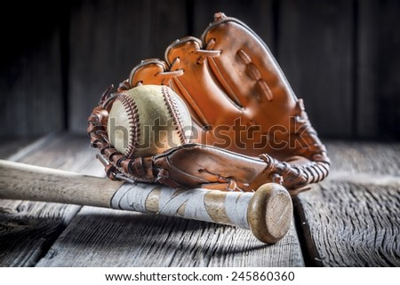 Vintage baseball ball and golden glove