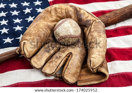 Vintage baseball, bat and glove on an American flag