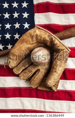 Vintage baseball, glove and bat on an American flag