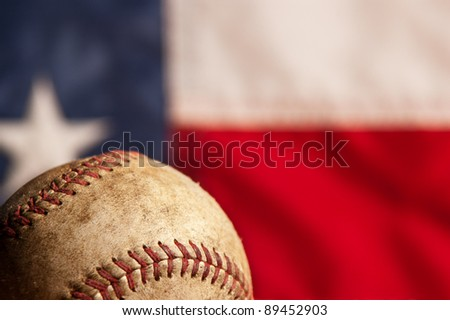 Vintage baseball on vintage American flag background