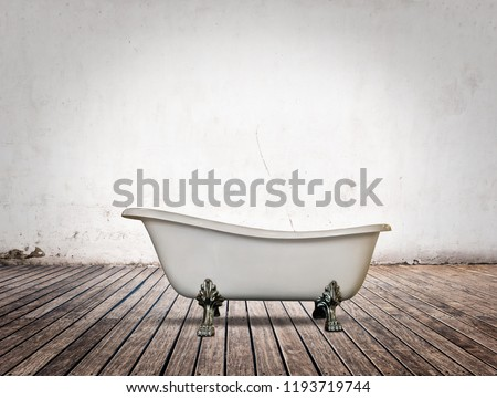vintage bathtub in bathroom with white wall and wood floor