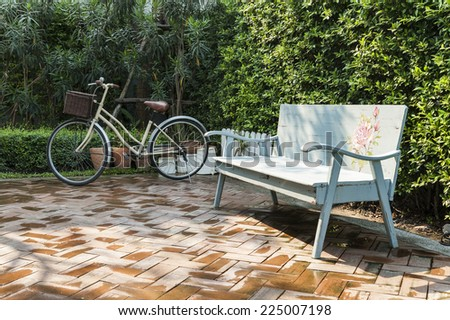 vintage bench and bicycle in...
