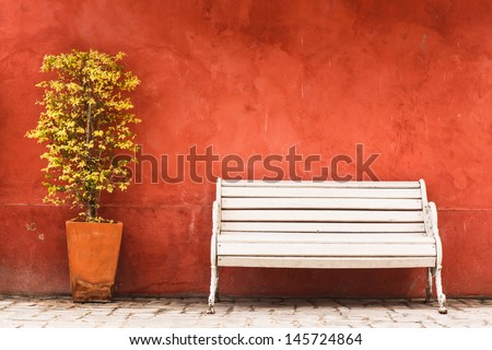 Vintage Bench and tree against blank wall