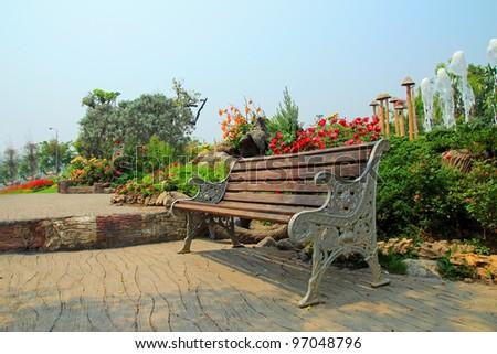 Vintage Bench in garden - stock photo