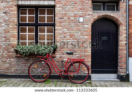 Vintage Bicycle Against House Wall #113333605