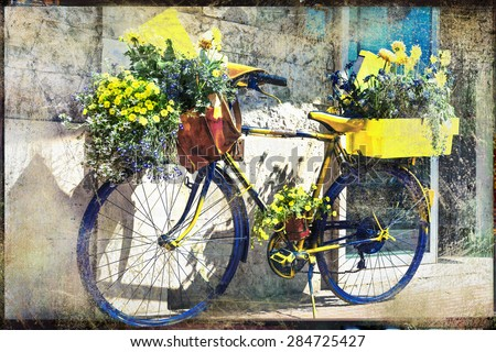 vintage bicycle decorated with flowers, artistic retro picture
