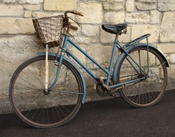 Vintage Bicycle Leaning against a Stone Wall