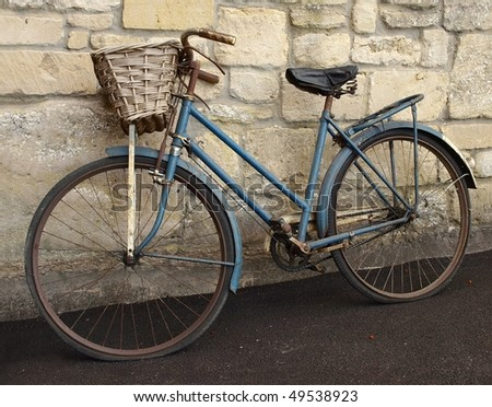 vintage bicycle leaning against ...
