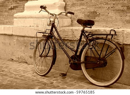 vintage bicycle leaning on a...