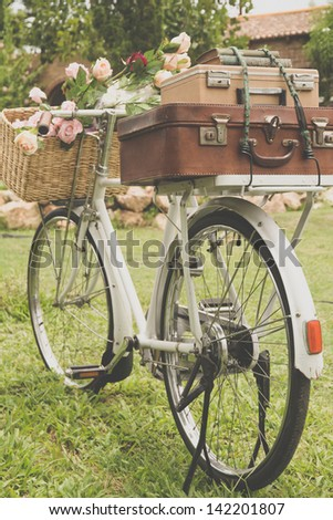 Vintage bicycle on the field with a bag