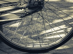 Vintage bicycle wheel on the pavement.