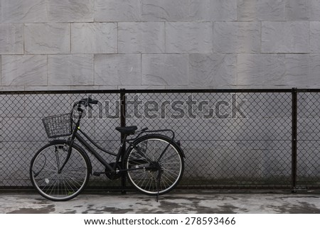 vintage bicycle with fence and...
