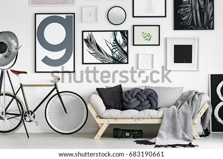 Vintage bike by wooden sofa in scandinavian style living room