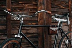 vintage bike on the dark wood background