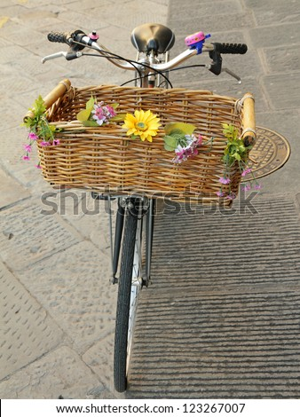 vintage bike with straw basket with flowers, Florence, Europe