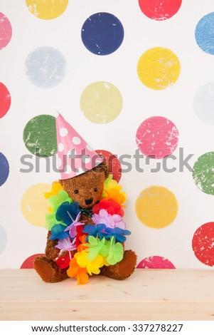 vintage birthday bear in colorful nursery room