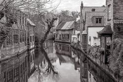 Vintage black and white canal with medieval houses, Bruges (Brugge), West Flanders, Belgium.