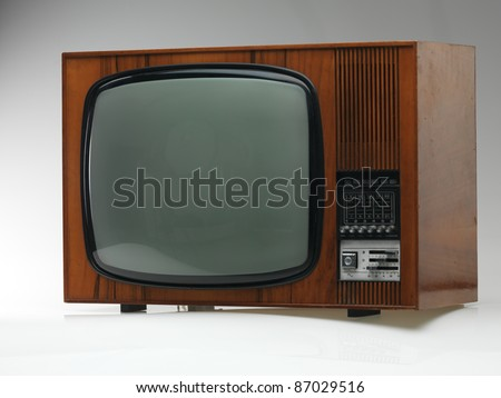 vintage black and white tv on gray background, side view