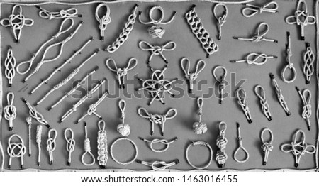 Vintage black and white wall background texture of navy nautical marine sailors binding knots. #1463016455