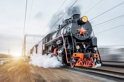 Vintage black steam locomotive train rush railway.