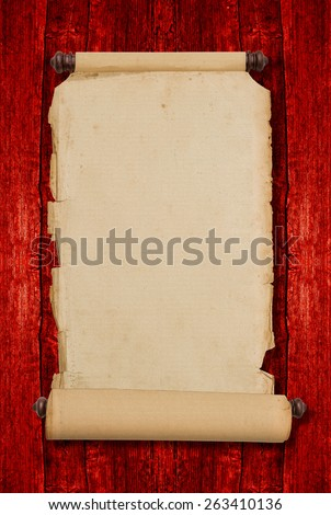 Vintage blank aged paper scroll on red wooden background with copy space. Antique style parchment manuscript